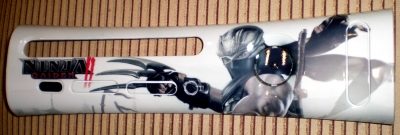 This is a custom printed faceplate featuring artwork from the game Ninja Gaiden II.