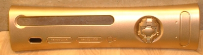 Gold plate with a gold painted Master Chief helmet attached to the power button.